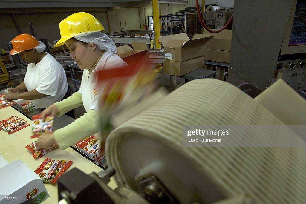 Workers sort bags of jelly beans on the assembly line at the Jelly Belly Factory April 2, 2007 in Fairfield, California. The Jelly Belly Factory produces approximately 14 billion jelly beans a year. With less than a week before Easter Sunday, retailers stock their shelves full of jelly beans, chocolates, and other traditional candies for Easter.