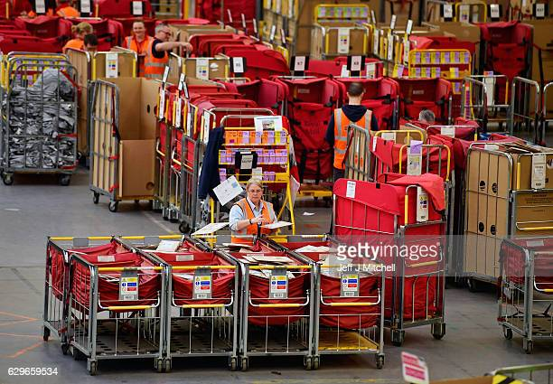 Workers sort mail at Scottish Distribution Centre before its loaded on The Royal Mail train and taken south on December 14 2016 in Wishaw Scotland In...