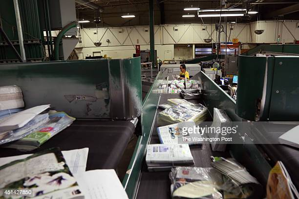 Workers sort mail at the Anchorage the Postal Service's processing and distribution center in Anchorage AK on May 12 2014 The Post Office must pay...