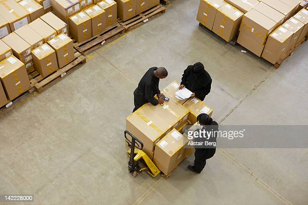 Workers sorting boxes in a warehouse