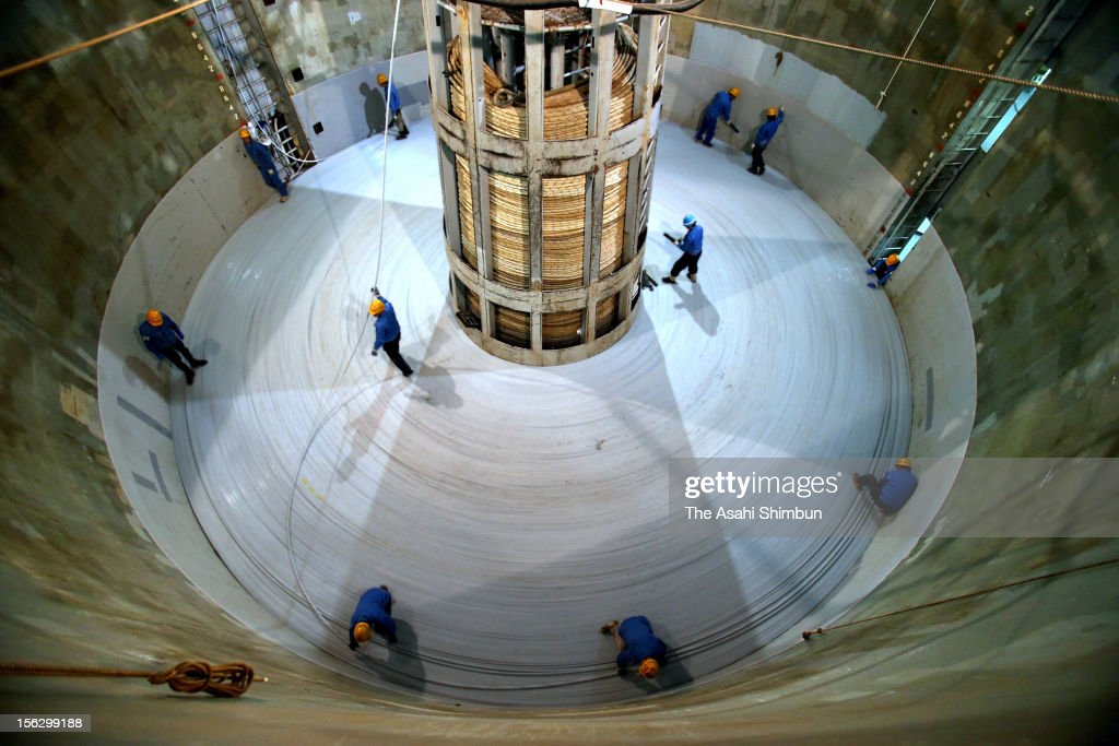 Workers spiral the water-proof fiber optic cable to the tank of laying operation vessel from the OCC (Ocean Cable & Communication) Kitakyushu Submarine Plant on November 12, 2012 in Kitakyushu, Fukuoka, Japan. The new, 32 billion Japanese yen project, to cope with the increasing demands of data communications, will connect Japan, Singapore, China and Thailand with high-speed fiber-optic cable, enable to transmit data equivalent to 2,000 movies in a second.