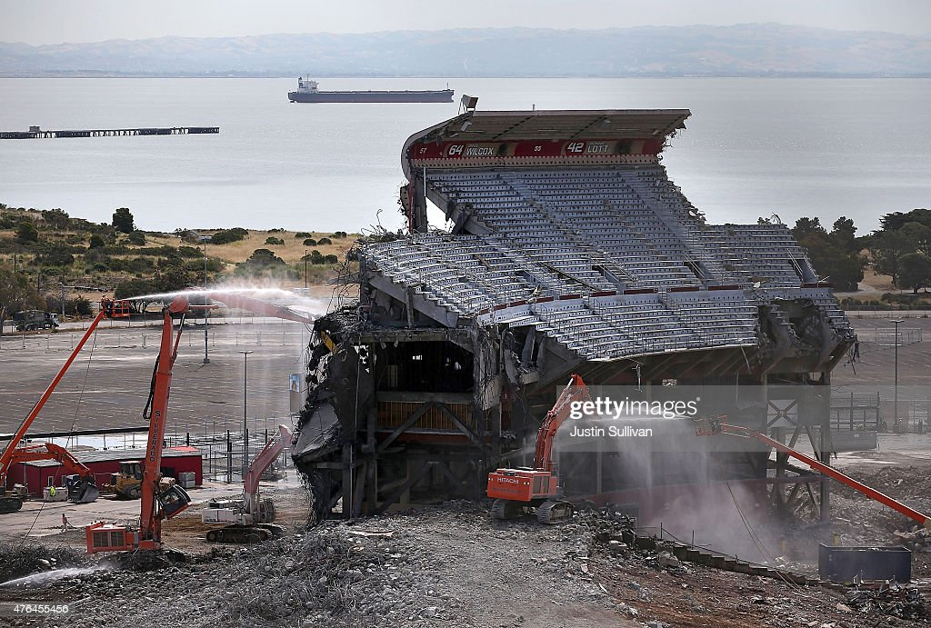 Workers spray water as a section of Candlestick Park is demolished on June 9 2015 in San Francisco California The demolition of Candlestick Park the...