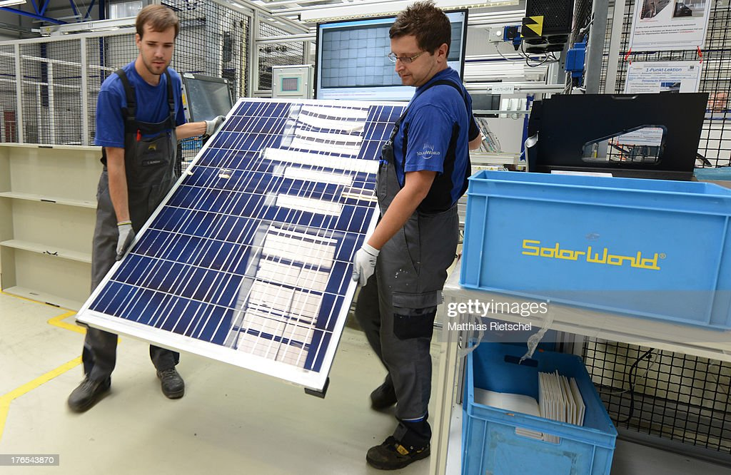 Workers stack finished solar energy panels at the Solarworld plant on August 14, 2013 in Freiberg, Germany. The troubled solar cells, modules and panels producer managed to recently avoid bankruptcy by reaching an agreement with its shareholders and other investors. Many solar energy equipment producers in Germany are facing difficult times due to stiff competition from China.