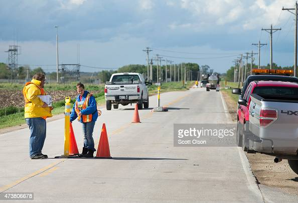 Workers staff a checkpoint set up on Buchanan Avenue near a farm operated by Daybreak Foods which has been designated 'bio security area' on May 17...