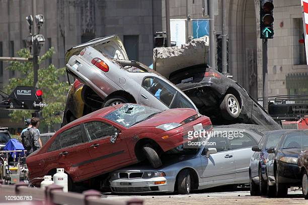 Workers stage a car accident on the Michigan Avenue during the filming of the movie Transformers 3 July 16 2010 in Chicago Illinois Sections of...