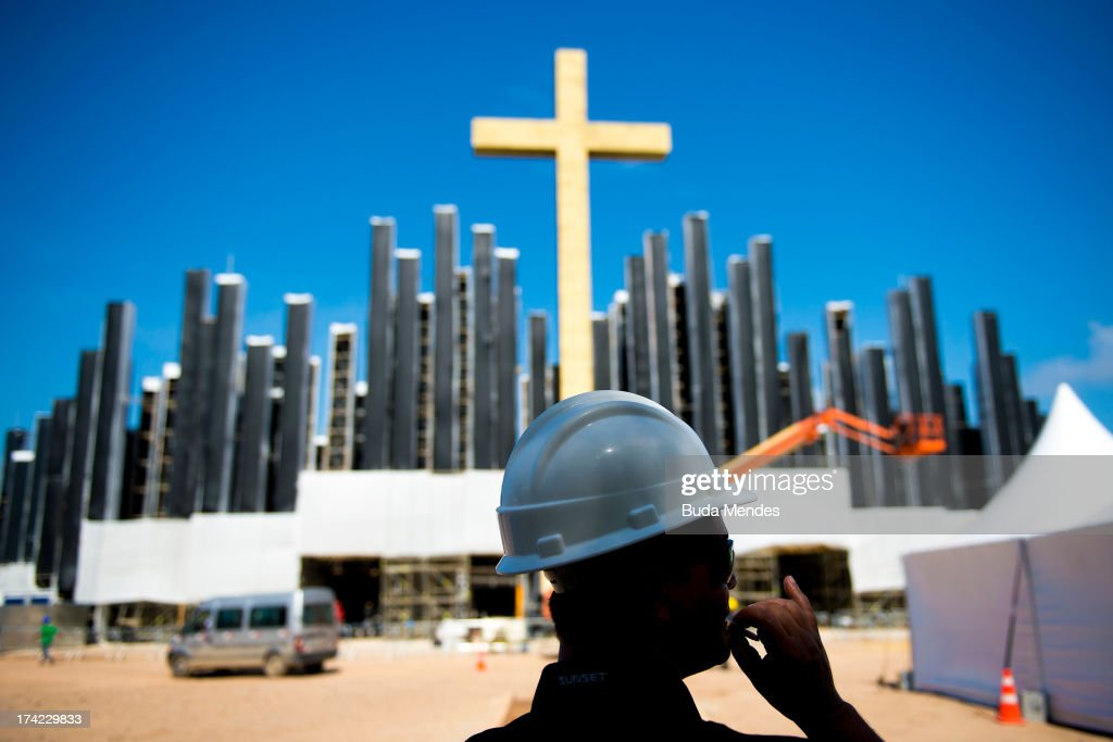 Workers stand as a cross is erected on a stage for a papal mass and youth vigil with Pope Francis on July 21, 2013 in Rio de Janeiro, Brazil. More than 1.5 million pilgrims are expected to join Pope Francis for his visit to the Catholic Church's XXVIII World Youth Day celebrations. The Pope, traveling on his first international trip, will be in Brazil from July 22 to 28.