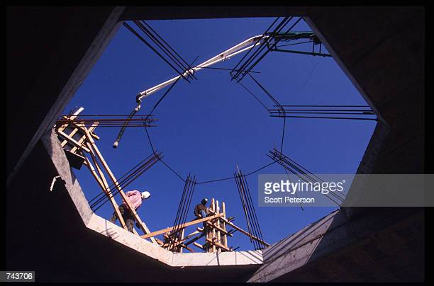 Workers stand at a petroleum plant near the Persian Gulf July 15 1996 in Jubayl Saudi Arabia Possessing twentyfive percent of the world's oil...