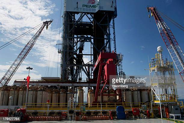 Workers stand in the shade on the Petroleos Mexicanos Centennial deep sea crude oil platform in the waters off Veracruz Mexico on Friday Aug30 2013...