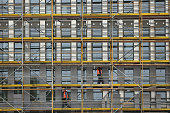 Workers stand on scaffolding at a construction site on October 14 2014 in Berlin Germany Germany Economy Minister Sigmar Gabriel is scheduled later...