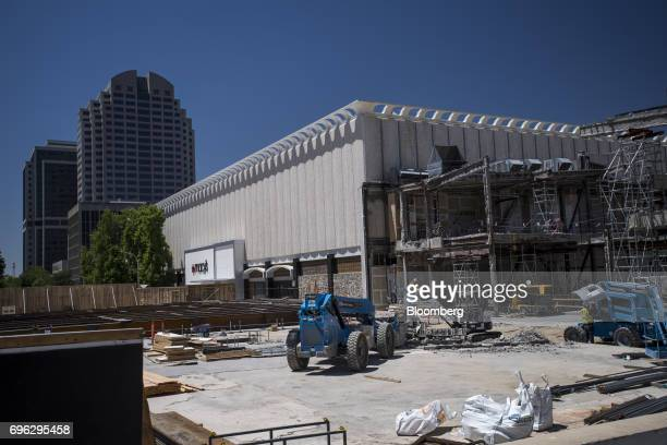 Workers stand on top of a building under construction in Sacramento California US on Tuesday June 6 2017 As the cost of daily life tests the bounds...