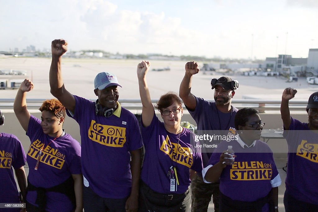 Workers stand together as they strike at the Fort LauderdaleHollywood Airport to protest what they say are repeat labor violations by airline...