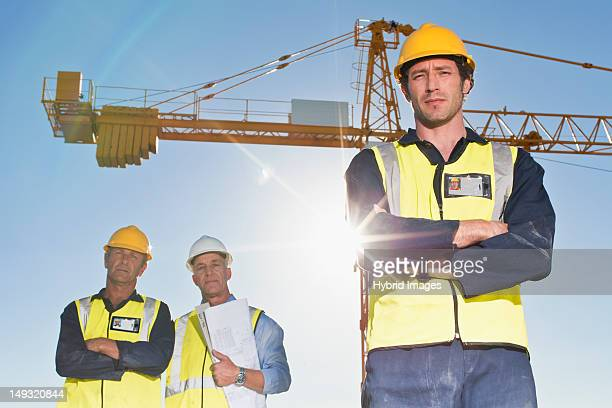 Workers standing at construction site