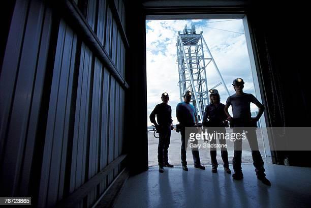 Workers standing by doorway