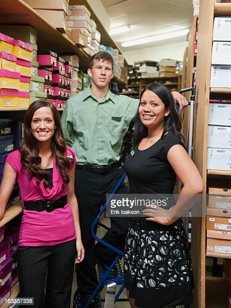 Workers standing in stockroom