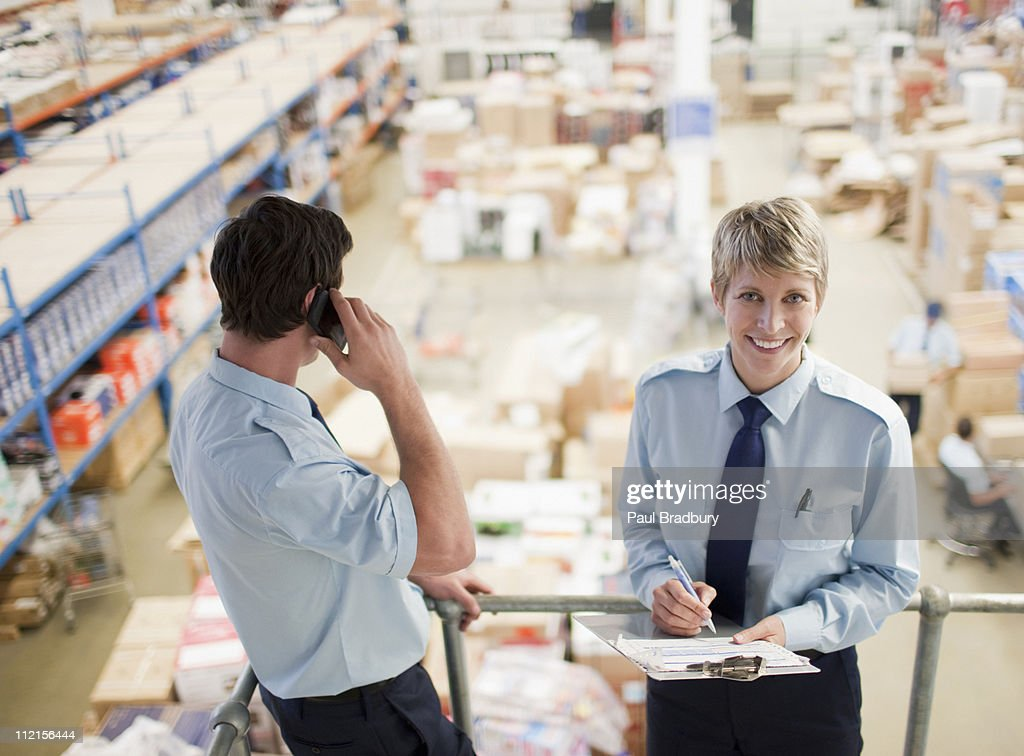 Workers standing together above shipping area : Stock Photo