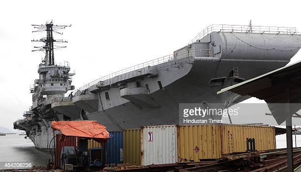 Workers start the breaking of decommissioned Indian Navy Ship Vikrant after Supreme Court allowed to scrap at Ratti Bunder on August 26 2014 in...