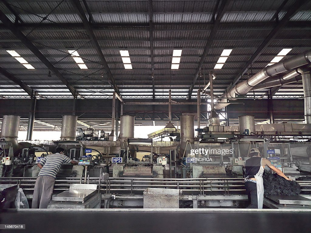 Workers supervising the production of rubber