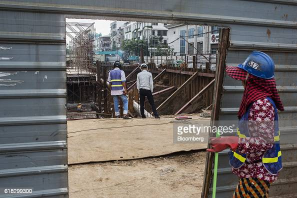 Workers survey a construction site in Phnom Penh Cambodia on Monday Oct 24 2016 Cambodia has a population of about 16 million people and gross...