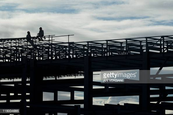 Workers take a break during the construction of the Abreu e Lima refinery at the Suape industrial complex of the Brazilian state oil company...