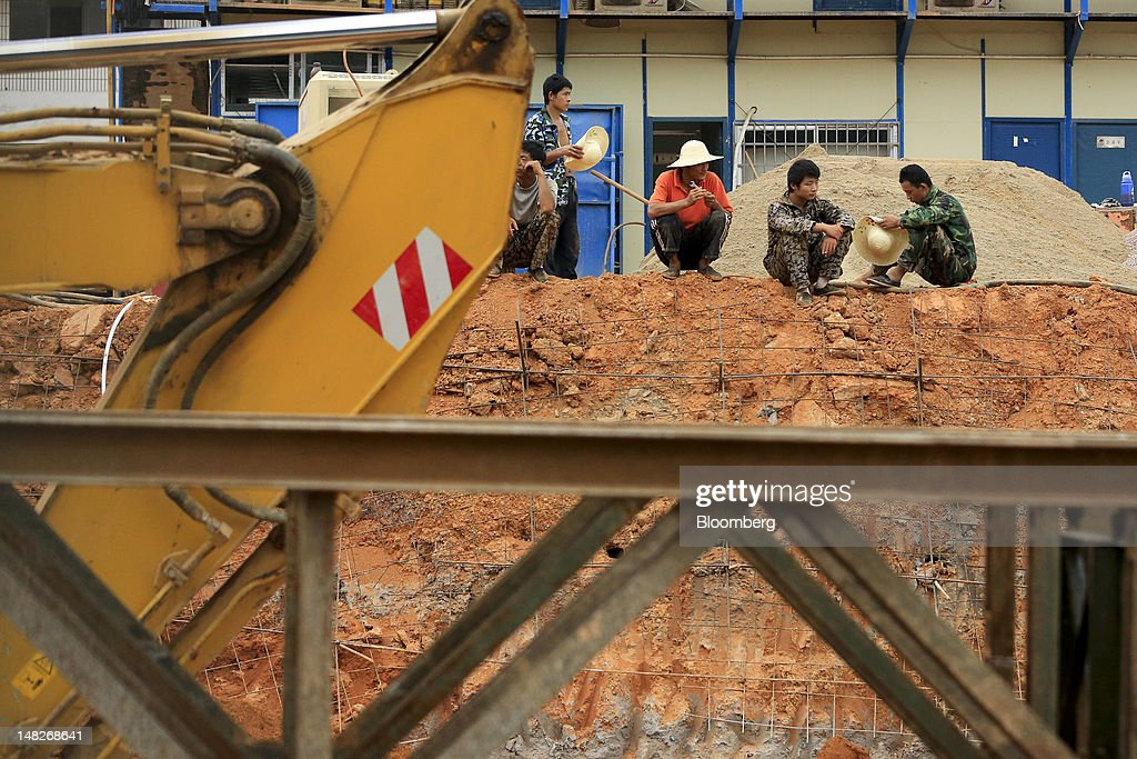 Workers take a break on the construction site for a station on Changsha's subway metro system in Changsha, Hunan Province, China, on Friday, July 13, 2012. Gross domestic product (GDP) expanded 7.6 percent in the second quarter of 2012 from a year earlier, China's National Bureau of Statistics said today in Beijing. Photographer: Nelson Ching/Bloomberg via Getty Images