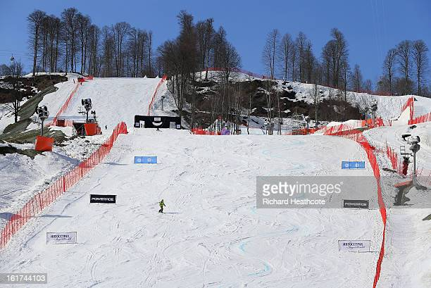Workers take the Snowboard Parallel Slalom course apart after the competition is cancelled due to high temperatures at the Rosa Khutor Extreme Park...