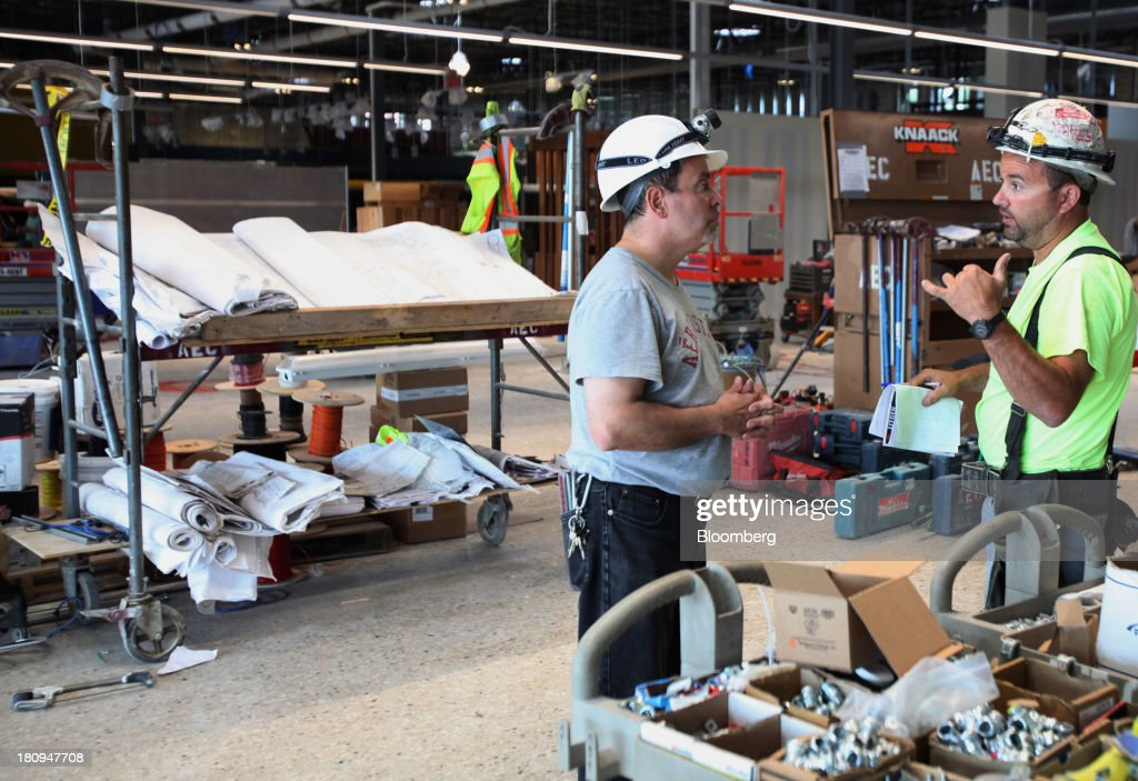 Workers talk inside a new Whole Foods Market Inc. store under construction in Park Ridge, Illinois, U.S., on Tuesday, Sept. 17, 2013. Whole Foods is currently scheduled to open eleven new stores in the U.S. and 2 in the U.K by the fall 2014, according to its website. Photographer: Tim Boyle/Bloomberg via Getty Images