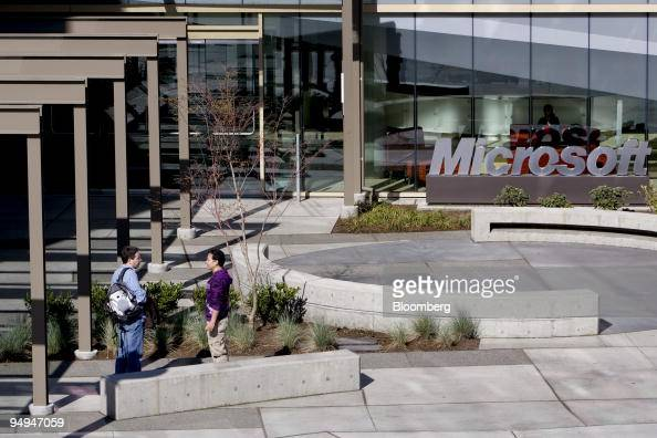 Workers talk outside a building on the Microsoft Corp campus in Redmond Washington US on Tuesday April 21 2009 Microsoft Corp the world's largest...