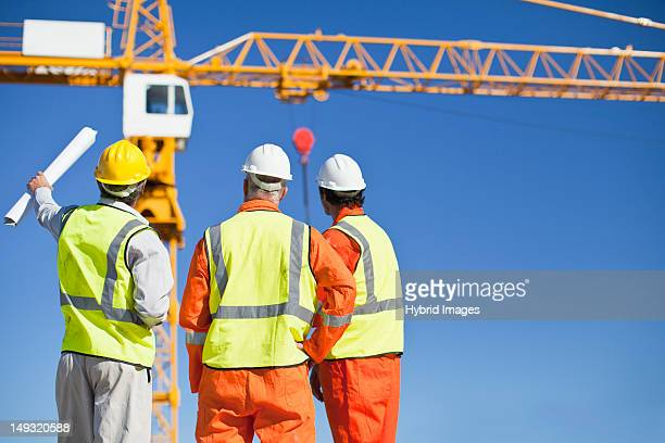 Workers talking at construction site