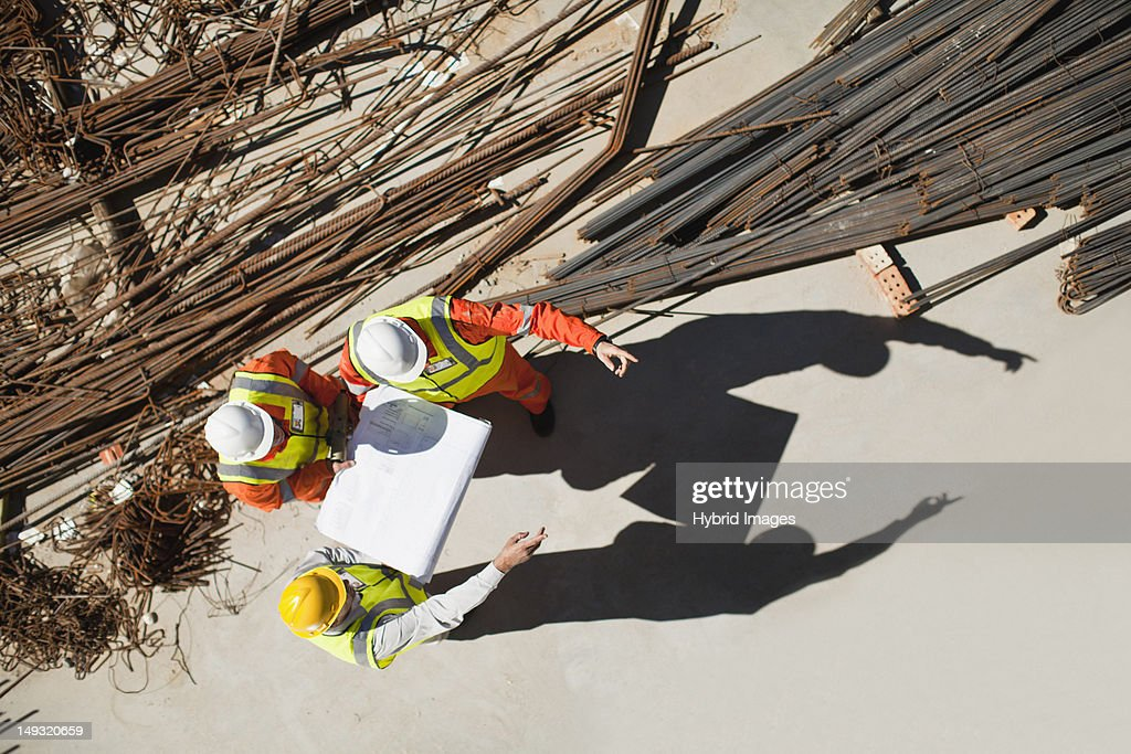 Workers talking at construction site : Stock Photo