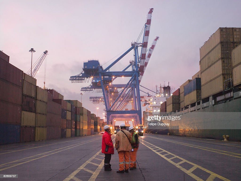 Workers talking in a shipping yard