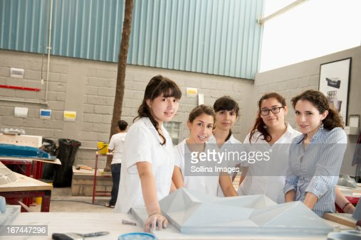 Workers talking in manufacturing plant : Stock Photo