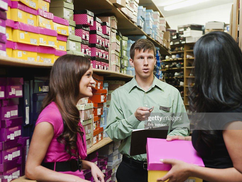 Workers talking in stockroom : Stock Photo