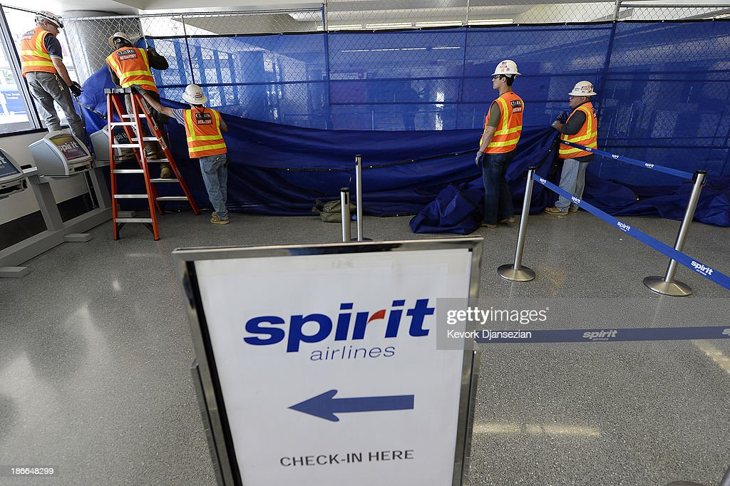 Workers tear down a temporary partition after Terminal 3 was re-opened a day after a shooting at Los Angeles International Airport November 2, 2013 in Los Angeles, California. The airport is almost back to normal operations a day after a man pulled out an assault rifle and shot his way through security at Terminal 3, killing one Transportation Security Administration worker and wounding several others. Federal officials identified the alleged gunman as Paul Ciancia, 23.