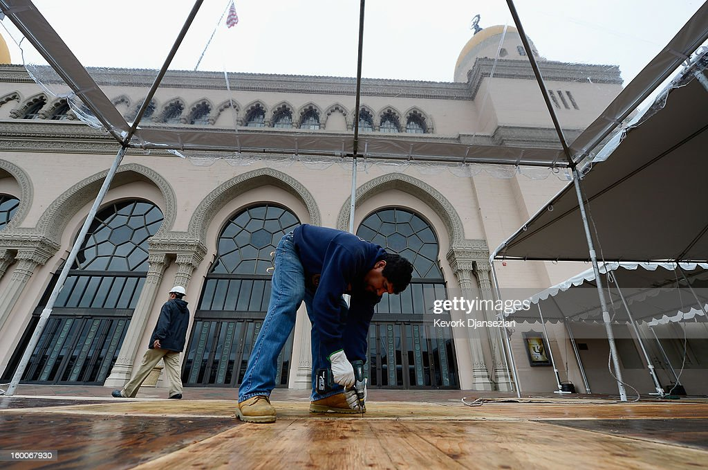 Workers tent the red carpet arrivals area from the rain in preparation of the 19th Annual Screen Actors Guild Awards at The Shrine Auditorium on January 25, 2013 in Los Angeles, California. The forcast calls for rain for the 19th Annual Screen Actors Guild Awards scheduled for Sunday January 27, 2013.