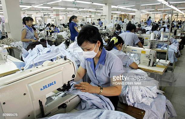 STORY 'VIETNAMCHINAUSEUTRADETEXTILES' Workers toil at a production line in garment factory No 10 in Hanoi 27 May 2005 Vietnam is watching China's...