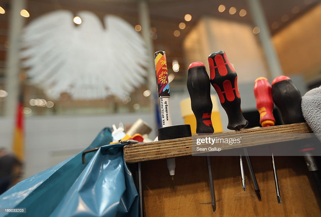 Workers' tools stand on a workbench in the plenary hall of the Bundestag while workers insatlled new desks and chairs on October 17, 2013 in Berlin, Germany. Workers installed new chairs and rearranged seating in order to accomodate the new constellation of party factions as well as the slightly higher number of parliamentarians voted in for the 18th legislative period following recent German elections. The new Bundestag will convene for th first time on October 22.