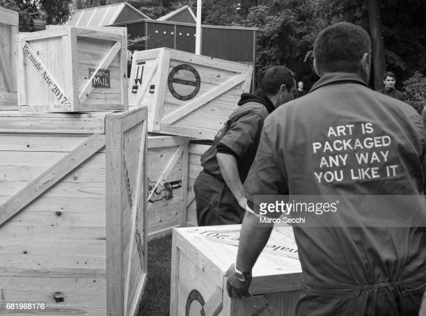 Workers transport wooden crates containing artwork at the Biennale Giardini on May 11 2017 in Venice Italy The 57th International Art Exhibition of...