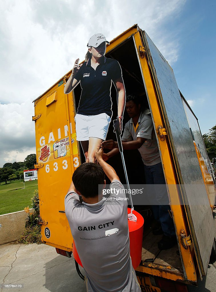 Workers unload a cutout of Stacy Lewis of the USA during the pro-am prior to the start of the HSBC Women's Champions at the Sentosa Golf Club on February 27, 2013 in Singapore, Singapore.