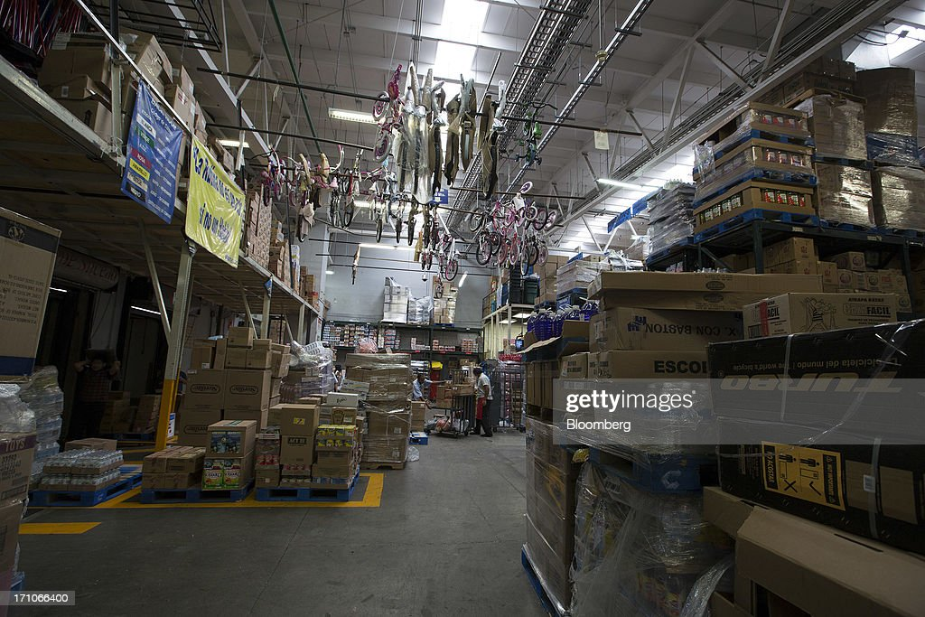Workers unload boxes of merchandise in the warehouse of a Wal-Mart Stores Inc. location in Mexico City, Mexico, on Thursday, June 20, 2013. Mexican retail sales rose 2.5 percent in April from the same month last year, the country's statistics agency, known as Inegi, reported on its website. Photographer: Susana Gonzalez/Bloomberg via Getty Images