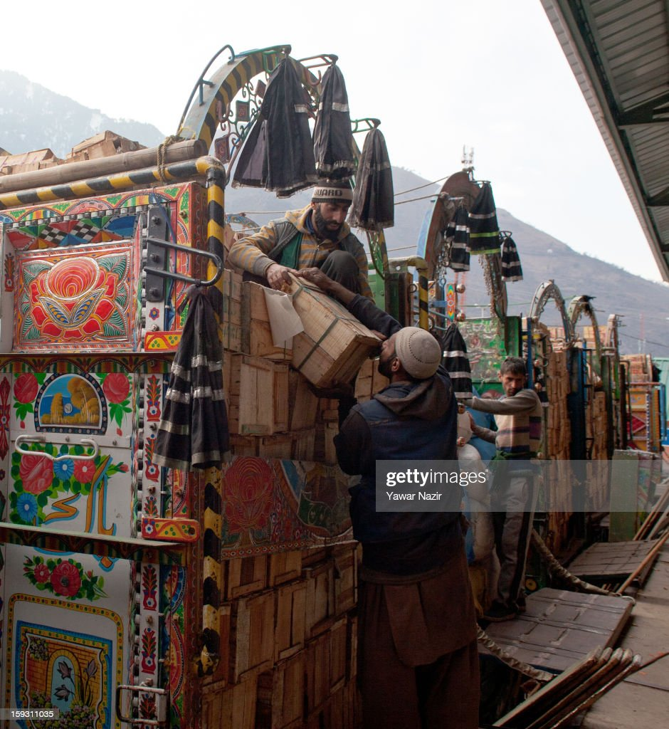 Workers unload goods from Pakistani vehicles at the trade facilitation centre in the border area near Uri on January 11, 2013 in Salamabad, 120 km (75 miles) northwest of Srinagar, the summer capital of Indian Administered Kashshmir, India. People living in the mountainous region along the Line of Control (LOC), a military line that divides Indian-administered Kashmir from the Pakistan-administered Kashmir have continually been at risk due to hostility between the armies of the two rival nations, but trade has been carried out smoothly across the Line of Control in North Kashmir. Two Indian and two Pakistani soldiers have been killed in the last week near the Line of Control dividing Kashmir, with both countries blaming each other for the escalating tension.