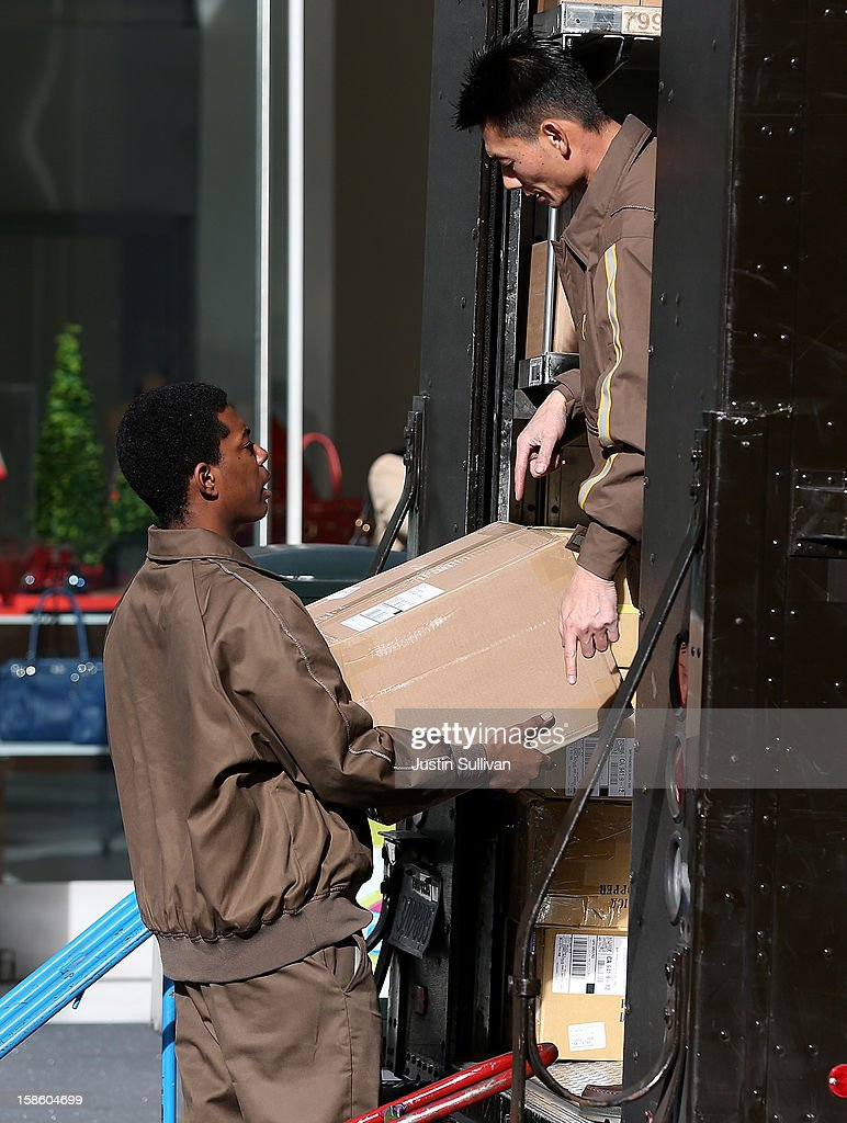 UPS workers unload packages from their truck on December 20, 2012 in San Francisco, California. With less than one week to go before Christmas, today is expected to be the busiest day in the history of UPS and they are expecting to ship an estimated 28 million packages around the globe.