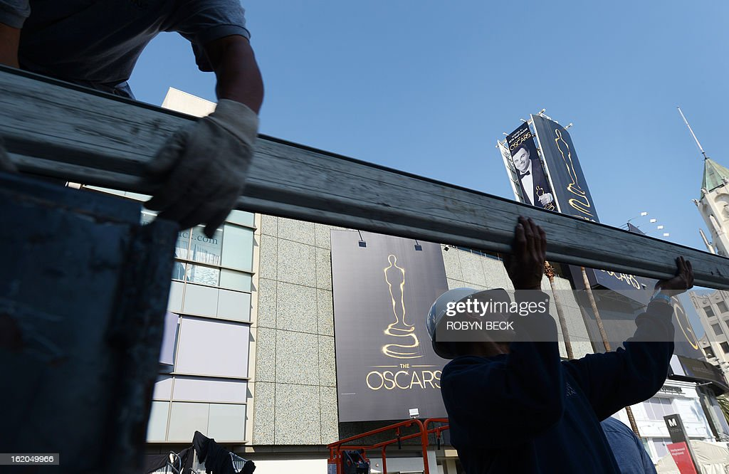 Workers unload pipes to begin building scaffolding in the center of Hollywood Boulevard for the 85th Academy Awards ceremony, February 18, 2013 in Hollywood, California. A section of Hollywood Boulevard in front of the Dolby Theatre will be closed for the entire week as crews build press risers and fan bleachers and roll out the red carpet for the Academy Awards ceremony, which will take place on February 24 in the Dolby Theatre. AFP PHOTO Robyn BECK