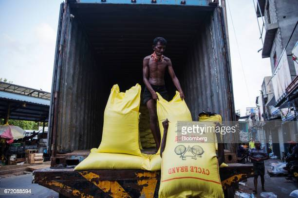 Workers unload sacks of rice from a truck in the Pettah neighborhood of Colombo Sri Lanka on Thursday April 20 2017 The Central Bank of Sri Lanka is...