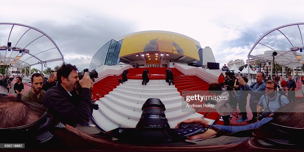 workers-unroll-the-red-carpet-prior-the-69th-annual-cannes-film-at-picture-id530218682