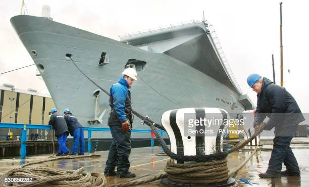 Workers untie the HMS Ark Royal as it sets sail from Rosyth Royal Dockyard following a two year 147 million refit programme It is the first time for...