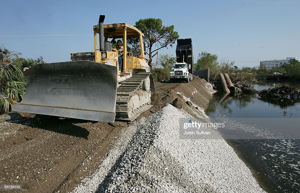 Workers use a bulldozer to smooth over gravel while repairing the London Canal levee which was breached during Hurricane Katrina September 21, 2005 in the Lakefront district of New Orleans, Louisiana. Workers are rushing to repair breaches in levees in preparation for Hurricane Rita, which could possibly hit the coast of Louisiana just three weeks after Hurricane Katrina.