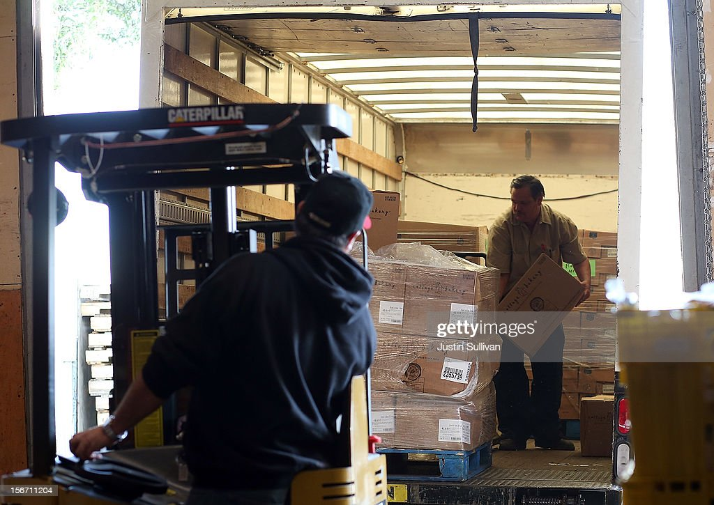 Workers use a forklift to move donated turkeys at the Bay Area Rescue Mission on November 19, 2012 in Richmond, California. Days ahead of Thanksgiving, the Bay Area Rescue Mission received a donation of 320 turkeys and 60 hams from local business Bay Alarm that will be used to feed a holiday meal to needy and underpriviledged people.