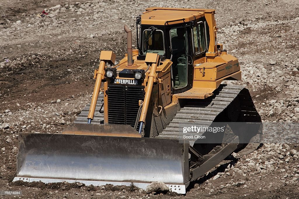 Workers use Caterpillar equipment at a construction site July 20 2007 in Chicago Illinois Caterpillar's stock price plummeted today after the heavy...
