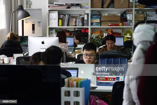 Workers use computers at their desks inside Tech Temple a coworking space for startup companies sponsored by Infinity Ventures Partners in Beijing...