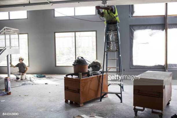 Workers use machinery to build a two story fitness center at the Irvine Spectrum Marriott International Inc hotel a project of RD Olson Development...